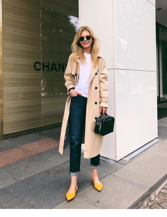 White top, jeans and a long coat