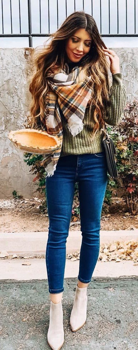 gray knit sweater and blue denim jeans
