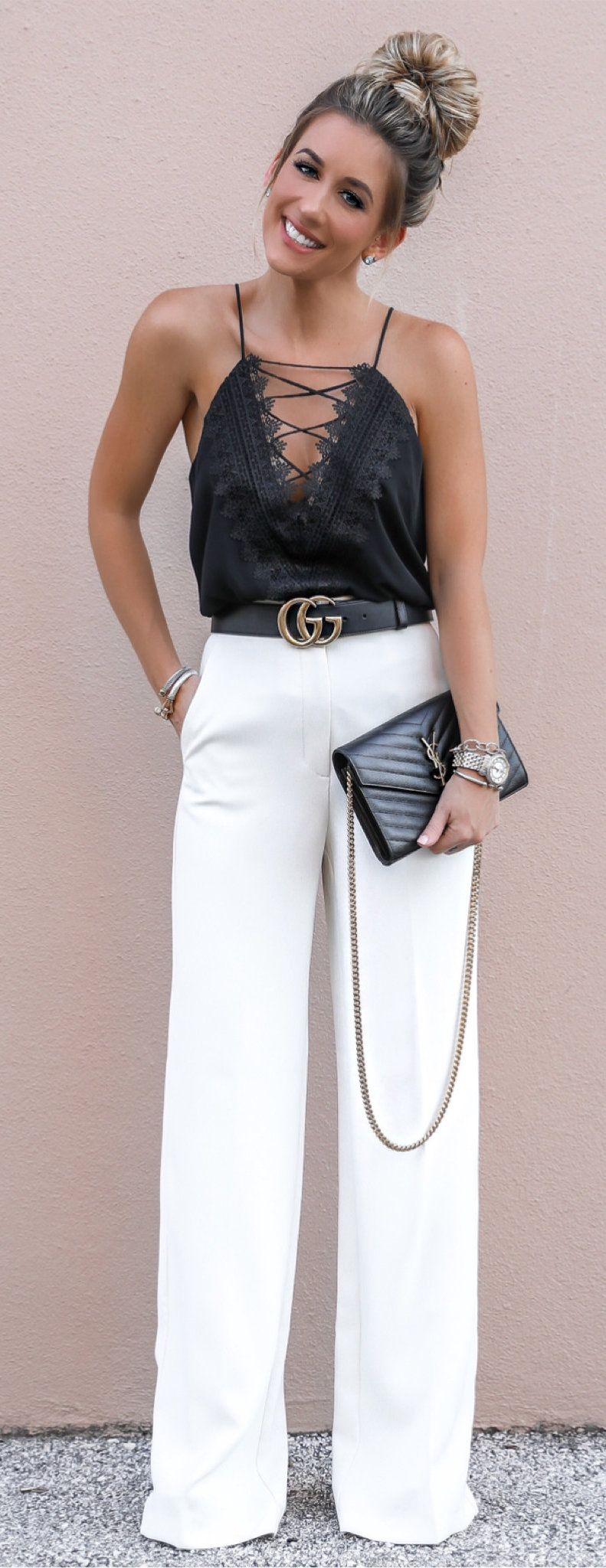 black spaghetti strap top and white dress pants