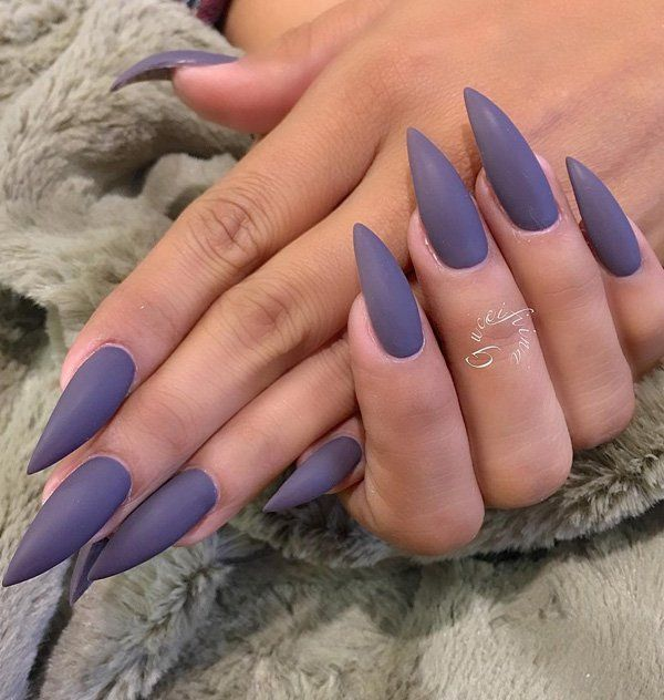 Long matte almond nails in violet color that is very classy. These nails are very long so if you are on vacation it can be very lovely manicure for you, but if you need to go on job, and work on computer think about shorter nails.
