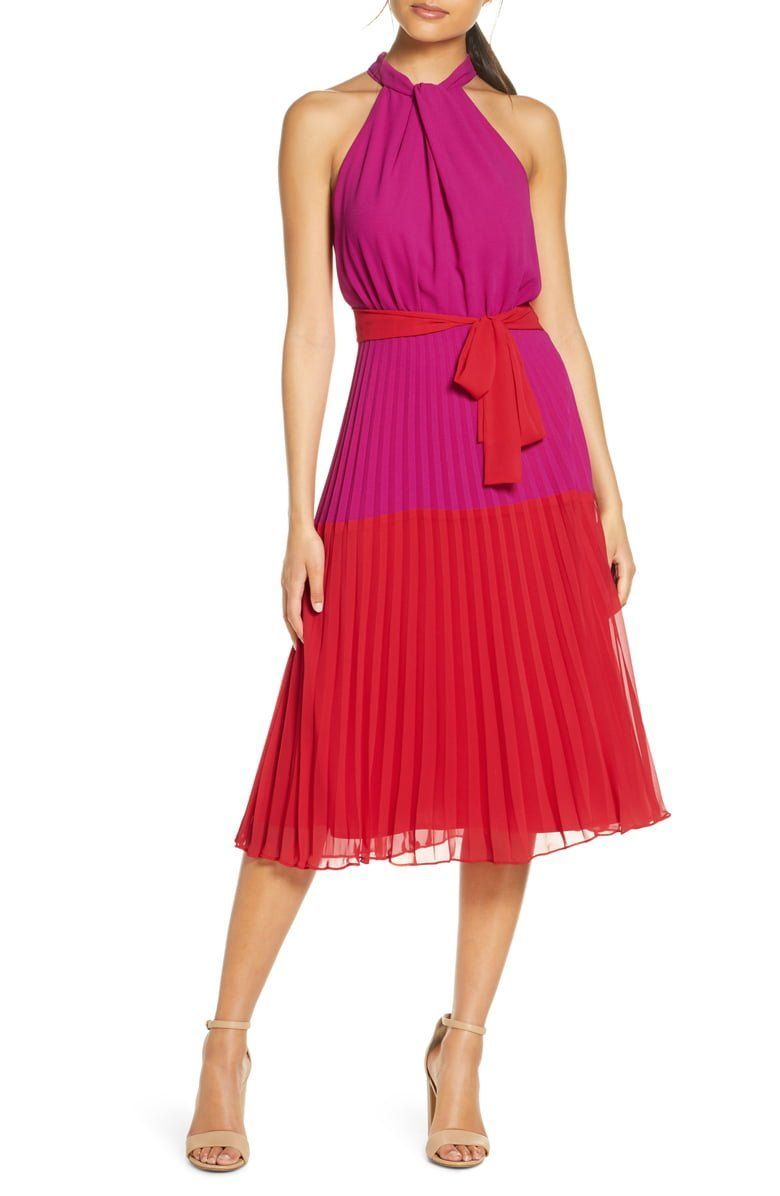 Two punchy colors and a swishy pleated skirt are all you need for a fun day out in this chiffon midi dress with twisted high neckline.