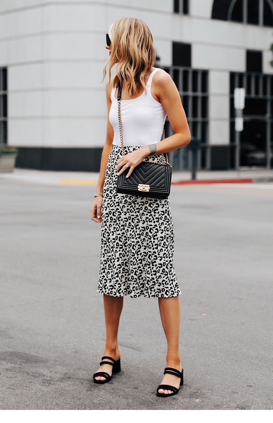 White top, leo skirt and black accessories