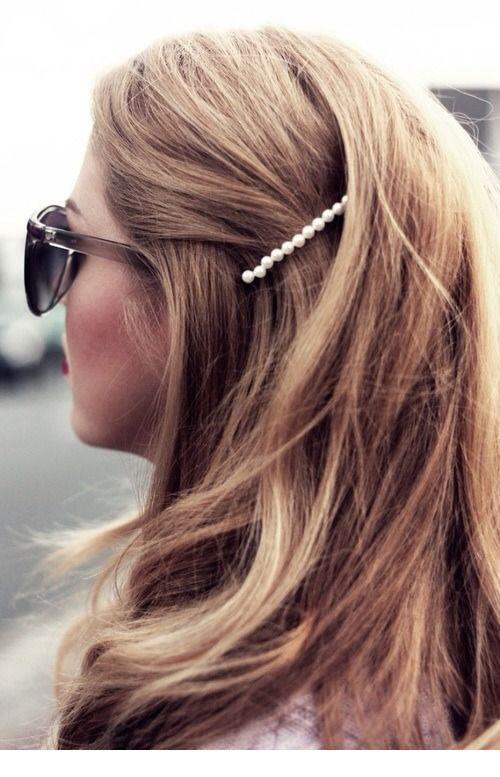 Sunglasses and pearl hair pin