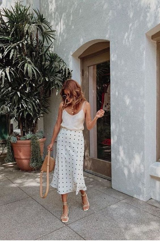 White top, long polka dot skirt and some accessories