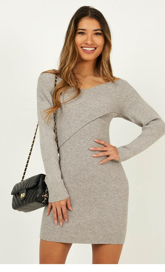 Grey short sweater dress and a little black bag