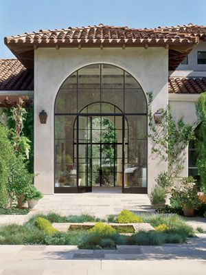 Love the doors within the large, arched windows.  Gorgeous design.