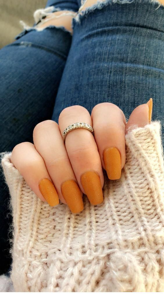 Cool orange nails with a ring