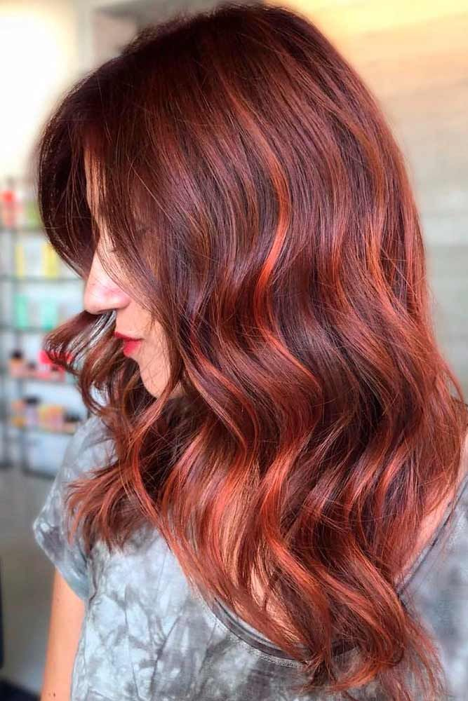 Reddish Brown #reddishhair #wavyhairstyles ★ Brown hair is often considered to be understated, but we think it is stunning and sexy. See these 20 sultry shades of brown for summer fun in the sun! #glaminati #lifestyle #brownhair