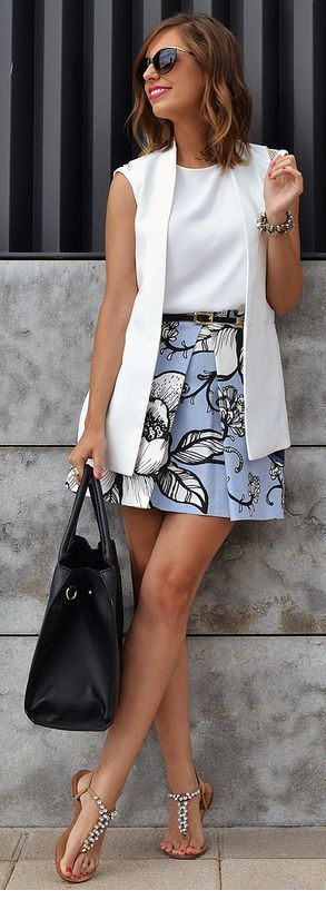 White top and vest with printed skirt
