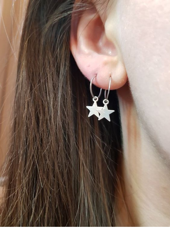 Two earrings with stars