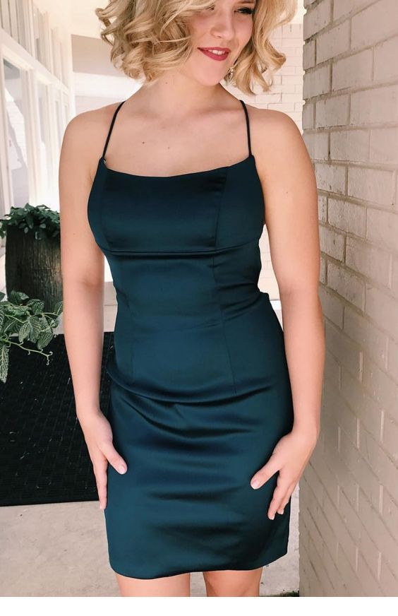A special simple black dress with short blonde hair