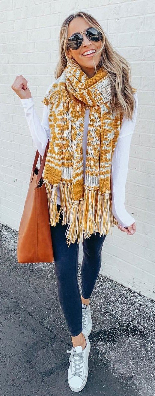 brown and white scarf with fringe