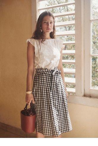 White top and plaid midi skirt