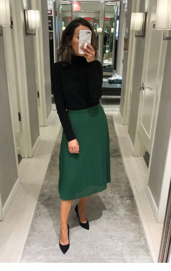 Black blouse and green midi skirt