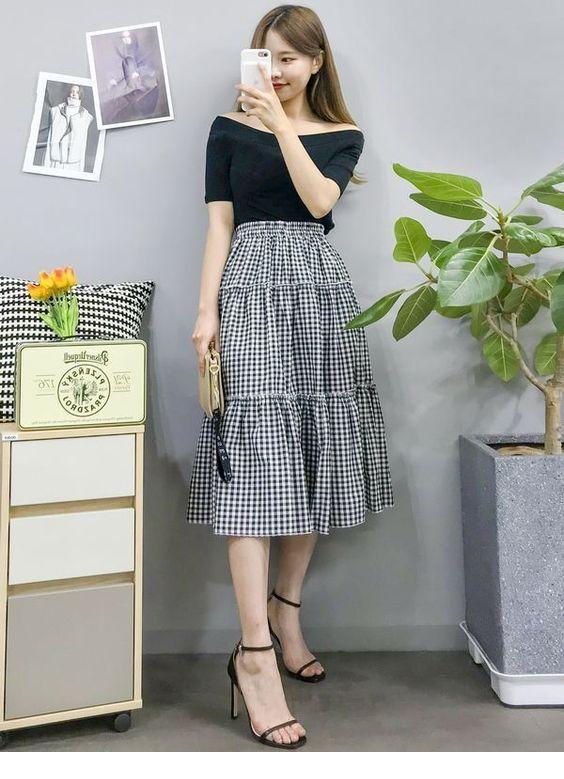 Cute black blouse and plaid long skirt