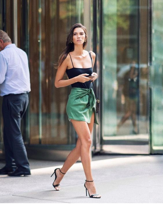 Black top and sandals with olive skirt