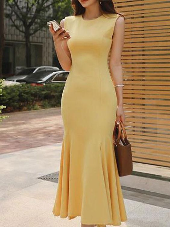 A very cute yellow dress with brown bag