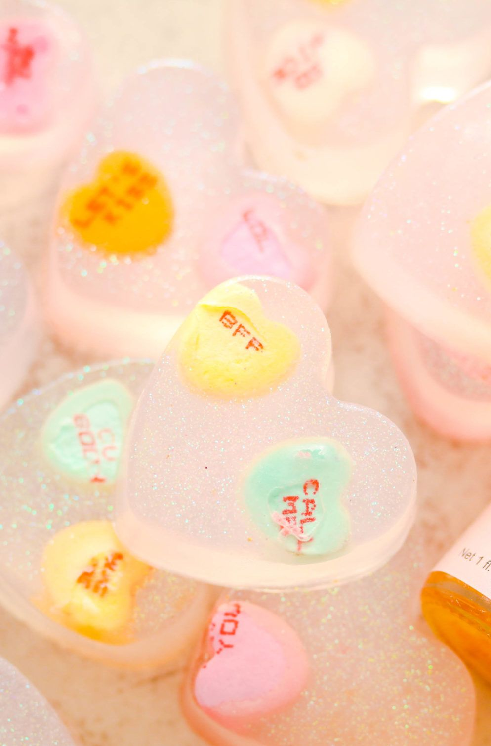 Make this easy valentines day conversation hearts soap DIY made with real candy! It makes the perfect gift!