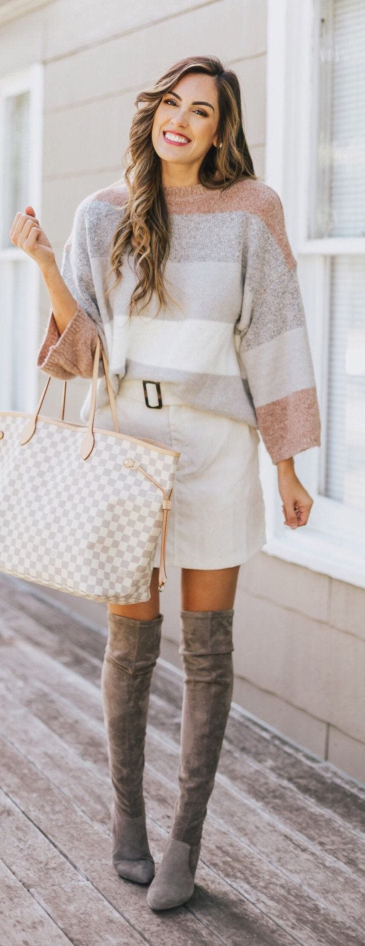 multicolored sweater, white skirt, and pair of gray thigh-high boots