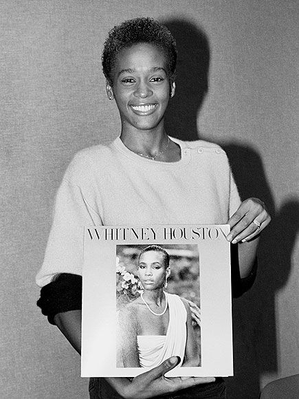 """OFF THE CHARTS photo   Whitney Houston - Holding her album here released in March 1985, she was established as a major recording artist.  Rolling Stone magazine raved, """"With her sleek beauty and her great voice, Whitney Houston is obviously headed for stardom."""""""