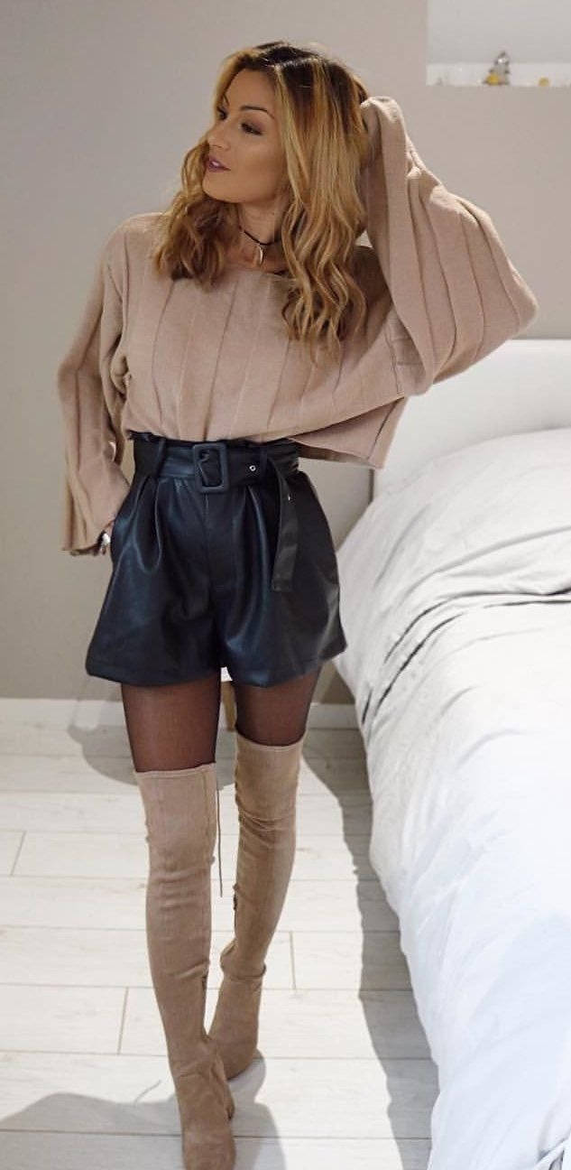 beige long-sleeved shirt, black skirt, and beige thigh-high boots