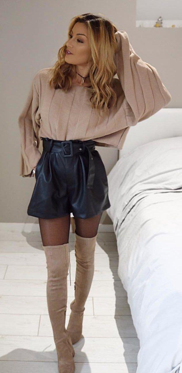 beige long-sleeved shirt, black skirt, and beige thigh-high boots