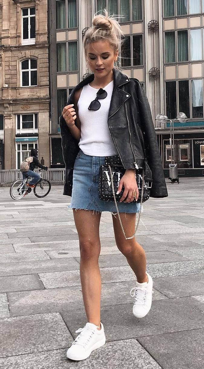 how to style a skirt : black leather jacket + white top + bag + sneakers