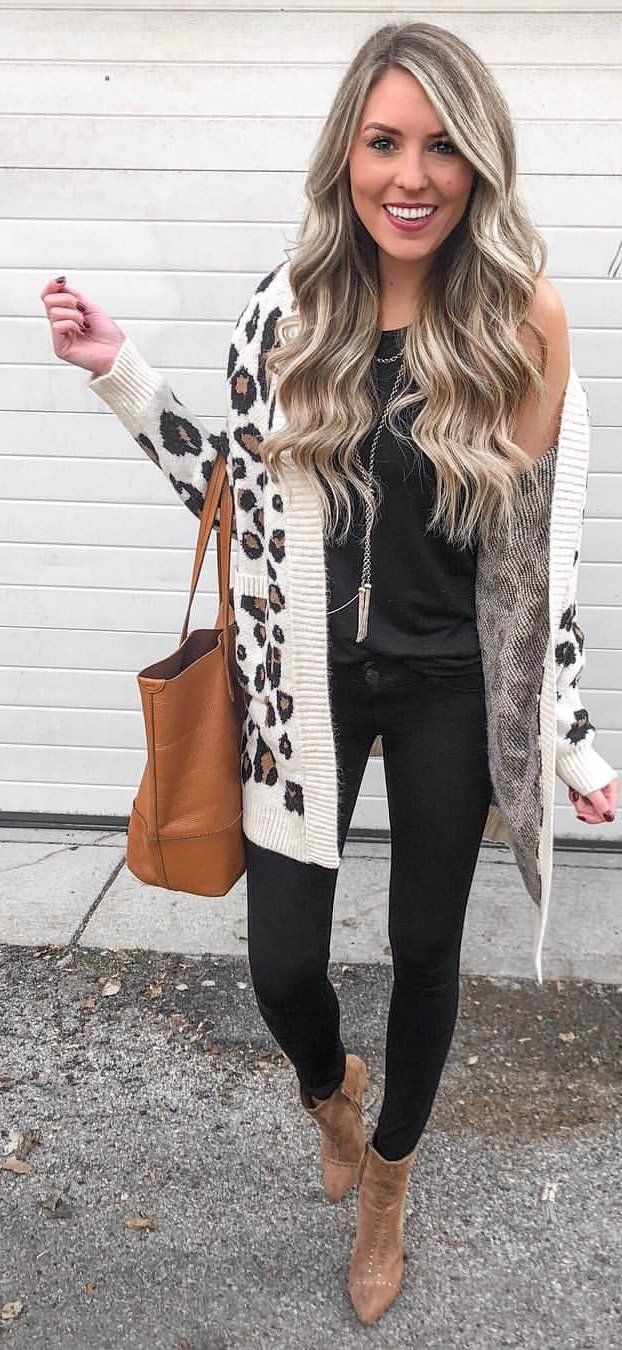 white, black, and brown cardigan