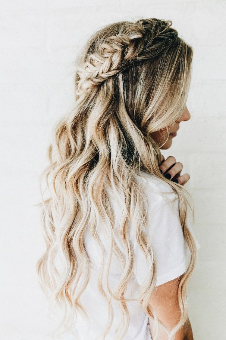 Blonde curled hair with intricate braid. Bridal hair