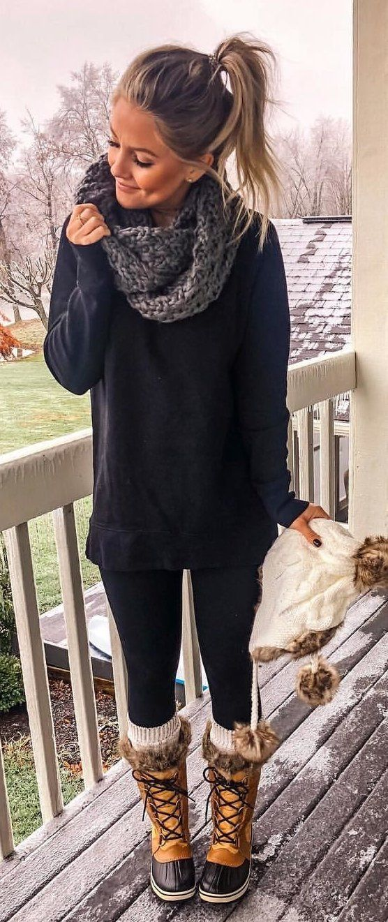 black sweater and gray scarf
