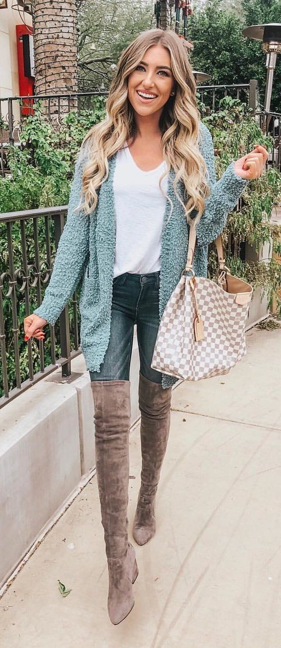 white crew-neck undershirt, green cardigan, blue denim jeans, and pair of brown velvet thigh-high booties outfit