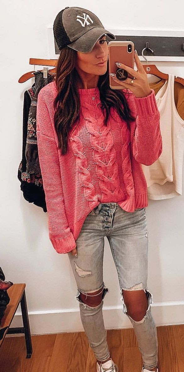 pink sweater and white distressed jeans