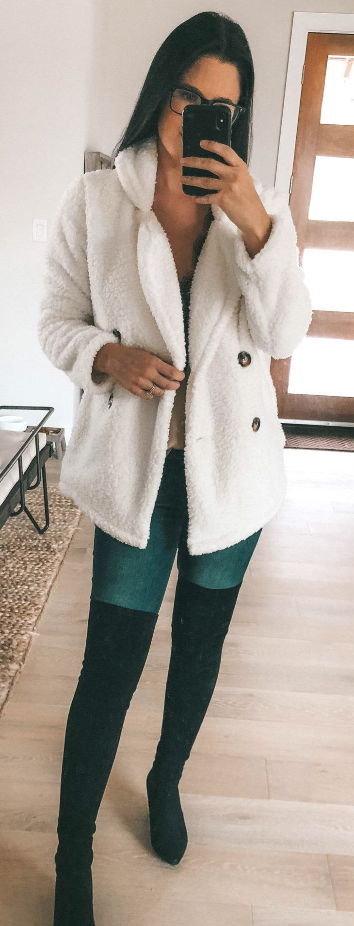 black and green leggings and white wool jacket