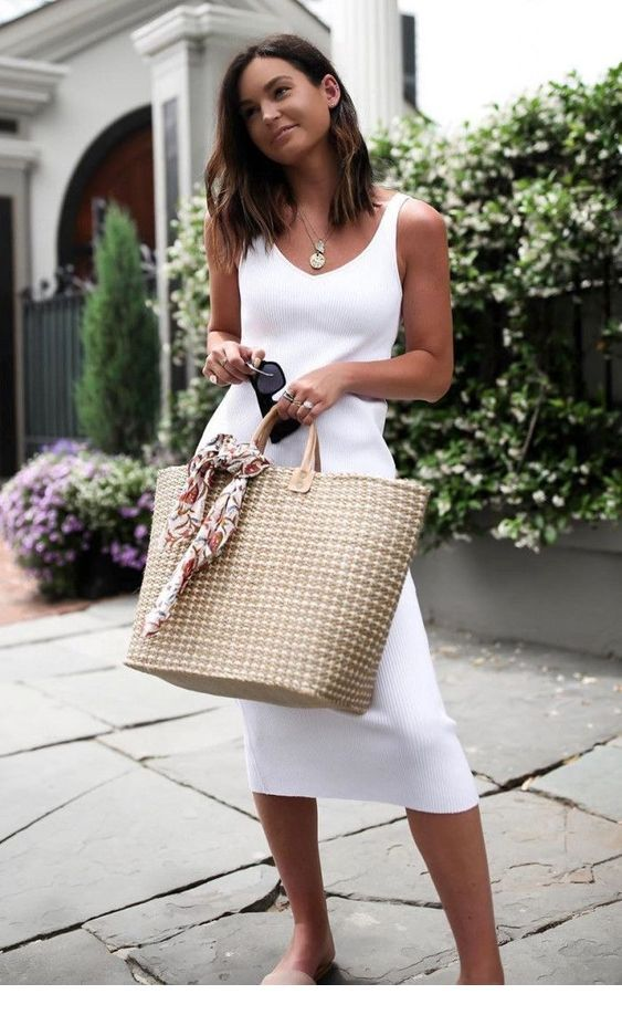 Simple white dress and a big bag