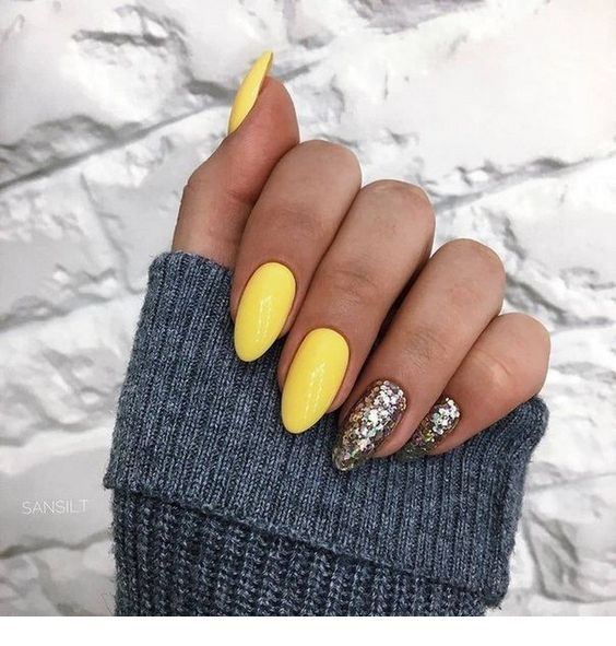 Very cute yellow nails with some glitter accents