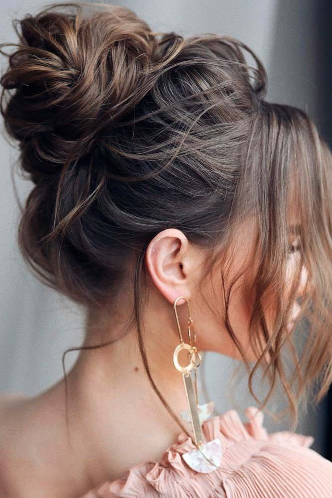 Messy Brown Updo #updohairstyles #messyhairstyles ★ It is time to start looking through hairstyles for prom as this special event is coming up. We have followed the trends to share them with you. #glaminati #lifestyle #chichairstylesforprom