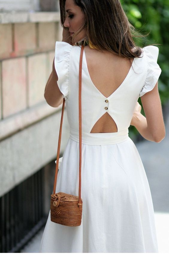 Beautiful white dress back with a sweet little bag