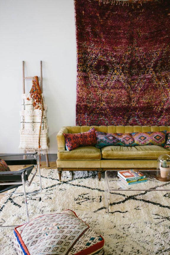 living room with moroccan rugs on the floor and walls. / sfgirlbybay #moroccandecorlivingroom