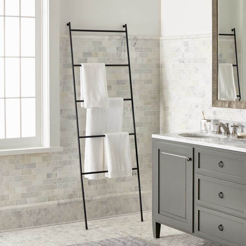Shop Jackson Black Towel Ladder. Streamlined in matte black iron, this towel ladder leans into space-saving and stylish storage. The minimalist design features four rungs and This clean-looking and space-saving design features four rungs for hanging everything from bath sheets to hand towels.