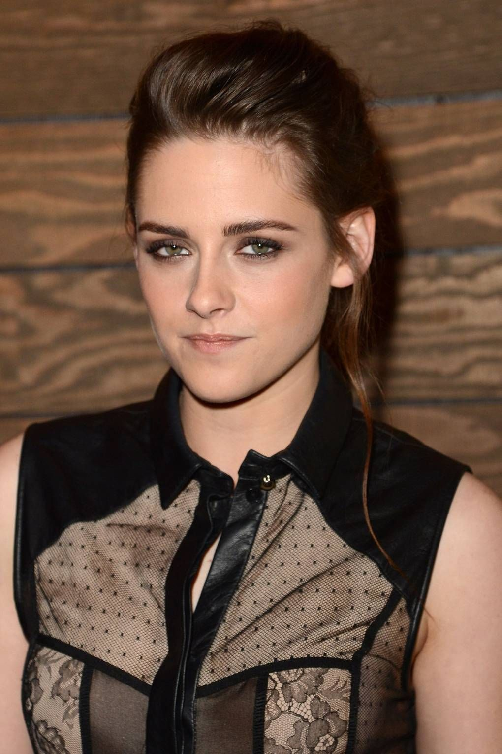 [b]2012[/b] One of our favourite Kristen looks to date: we love her swept-back up-do with pretty loose wave and her well-groomed bold brows. Not mine! Credit to Glamour.