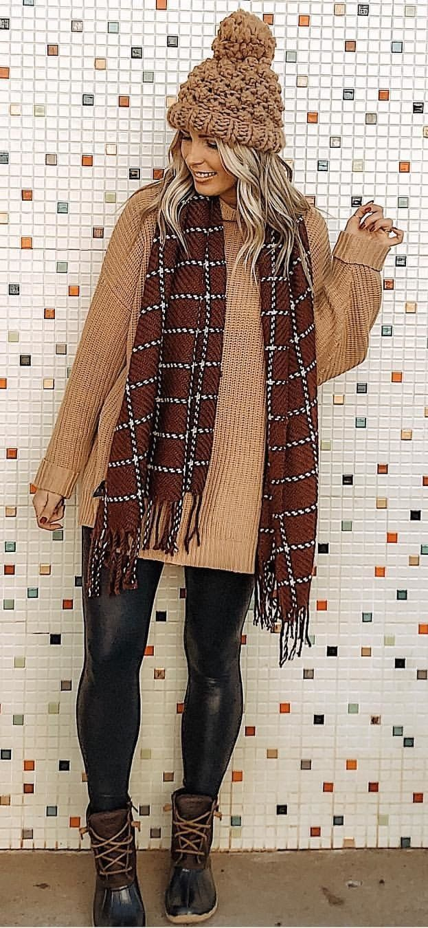 brown knit hat and coat