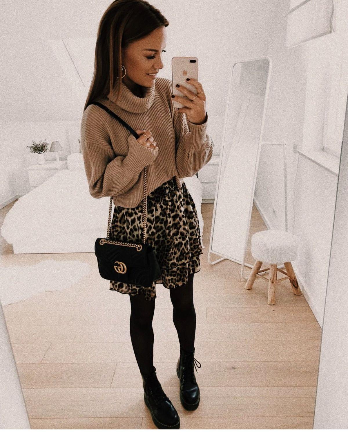Light brown sweater, animal print skirt