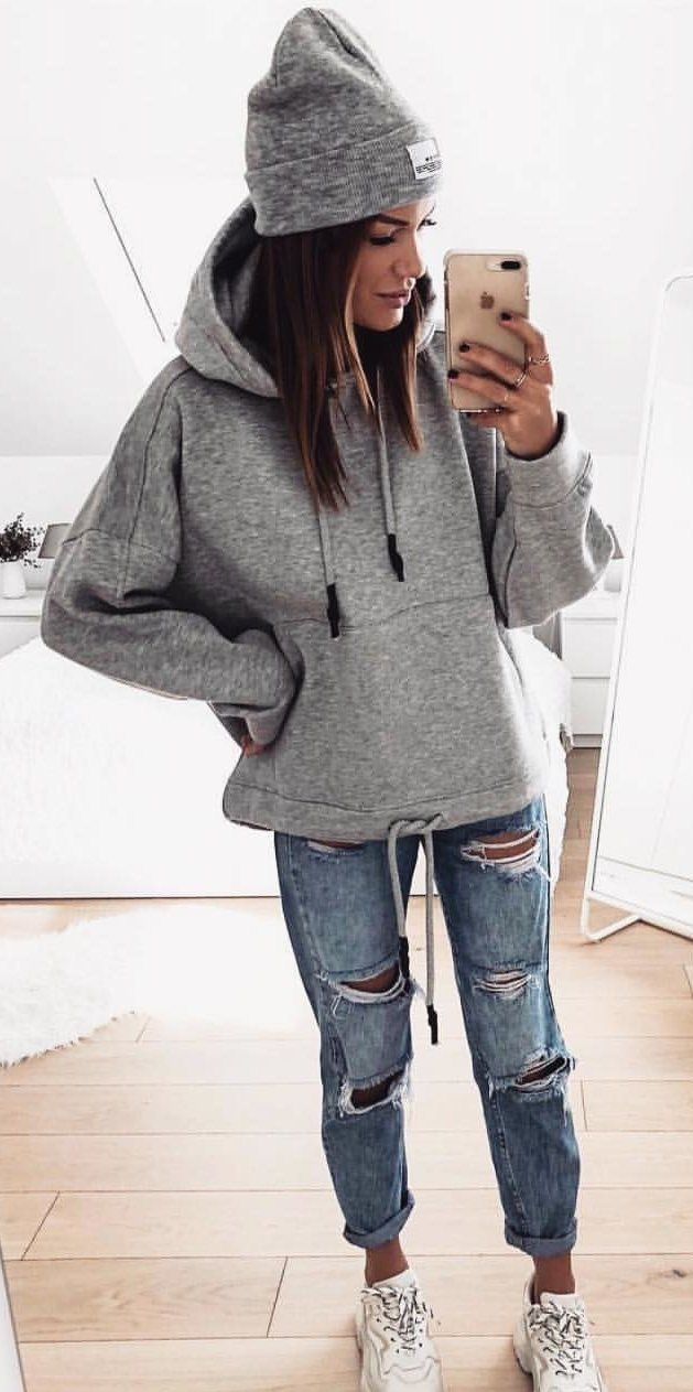 gray pullover hoodie and knit cap