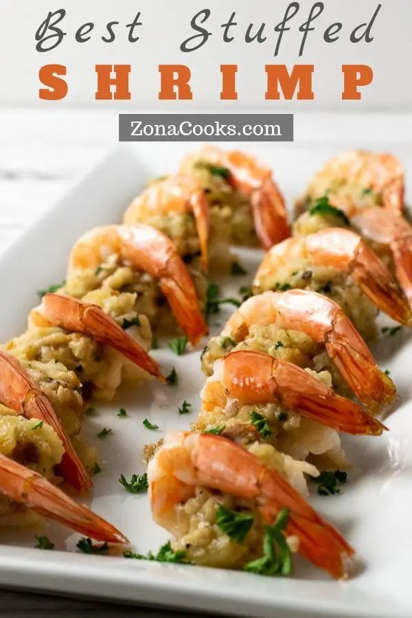 These stuffed shrimp are seriously the best! Butterflied shrimp are stuffed with a savory homemade stuffing mixture and baked in the oven. This recipe makes a great lunch, dinner or romantic date night meal for two but also works great as a Thanksgiving appetizer for a small dinner party. We serve ours with a nice garden salad on the side.