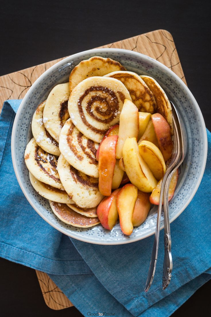 These cinnamon pancakes are an absolute treat. Packed with cinnamon spice and sugary icing goodness, they make for an amazing breakfast or brunch - they're even better for pancake day. They're vegan so anyone can enjoy them - better make a big batch! If you're looking for pancake day recipes or pankcake day inspiration then look no further. #pancakeday #pancakedayrecipes #pancakedayinspiration #pancakedayideas #cinnamonpancakes #pancakeswithcinnamon #brunchideas #brunchrecipes
