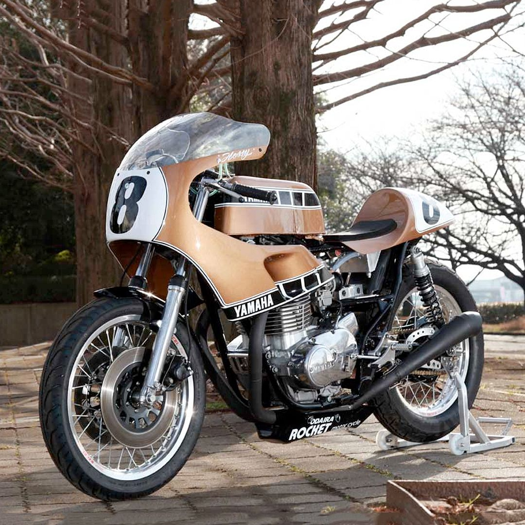 This Kenny Roberts-inspired XS650 is pushing all our nostalgia buttons. It comes from Yutaka Hoshi at Rocket Motorcycle in Japan, who built it as a tribute to King Kenny's illustrious career with Yamaha. It's a mash up of history; the donor is an XS650, as a nod the bike that Roberts piloted to flat track victory in 1973, but the overall look is a hat tip to his iconic TZ750 track bike.