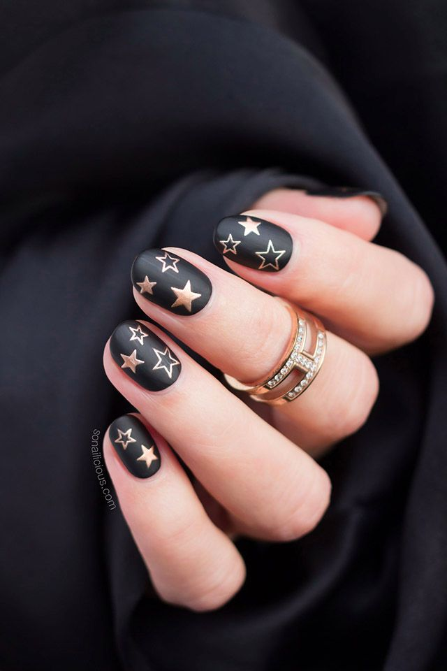 Christmas nails idea – Black and Gold Star nails. How-to on SoNailicious.com