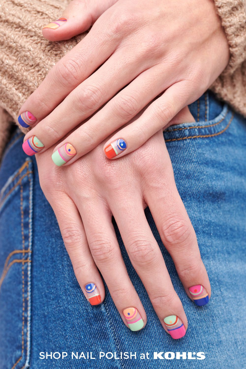 When it comes to spring nails, the brighter, the better. Go for the bold with standout shades from OPI. Ready to give the negative space manicure trend a try? Bring it to life with a playful mix of bright blues, reds, greens, oranges and pinks. Shop OPI nail polish and more at Kohl's and Kohls.com. #nails #spring