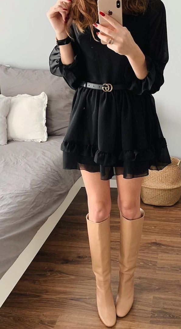 black long-sleeved mini dress and brown knee-high boots