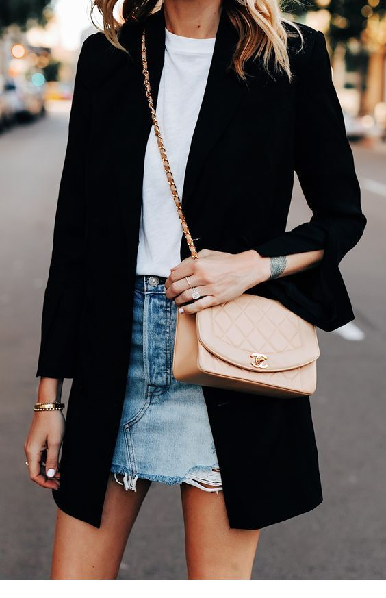 White top, denim skirt and black coat